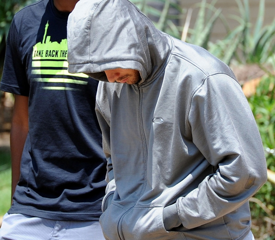 Olympic athlete Oscar Pistorius leaves the Boschkop police station, east of Pretoria, South Africa, Thursday, Feb. 14, 2013 en route to appear in court charged with murder. (AP / Chris Collingridge)