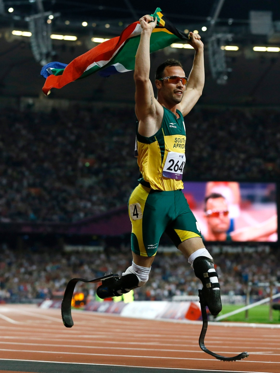 South Africa's Oscar Pistorius celebrates winning gold in the men's 400-metre T44 final at the 2012 Paralympics, Saturday, Sept. 8, 2012, in London. (AP / Kirsty Wigglesworth)
