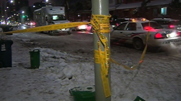 Police continue to investigate the scene where Toronto police Sgt. Ryan Russell was tragically killed, early Thursday, Jan. 13, 2011.