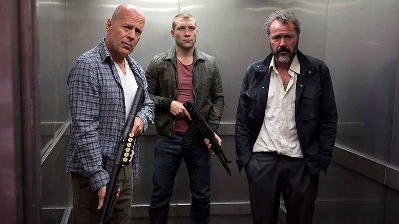Bruce Willis as John McClane, left, Jai Courtney as his son Jack, center and Sebastian Koch as Komarov in a scene from 20th Century Fox's 'A Good Day to Die Hard'