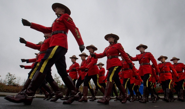 RCMP officers march in this 2012 file photo. (Darryl Dyck/THE CANADIAN PRESS)