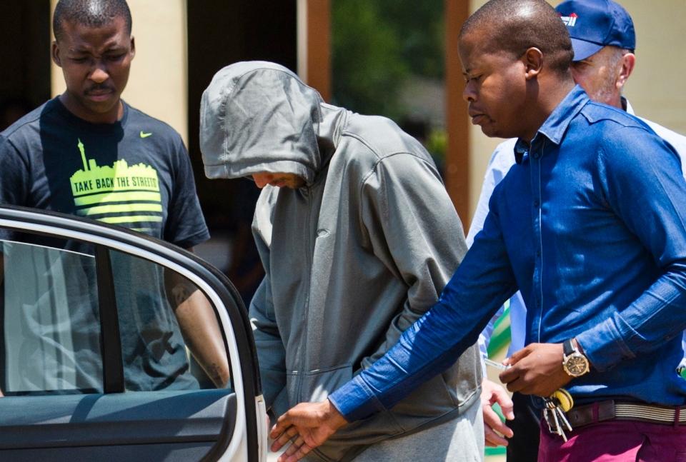 Olympic athlete Oscar Pistorius leaves the Boschkop police station east of Pretoria, South Africa on Thursday, Feb. 14, 2013. (AP Photo)