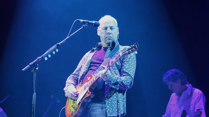 British musician Mark Knopfler performs at the SAP Arena in Mannheim, Germany, during his first show in Germany of his 2008 European tour, on Friday, April 11, 2008. Knopfler was head and co-founder of the band Dire Straits. (AP Photo/Daniel Roland)