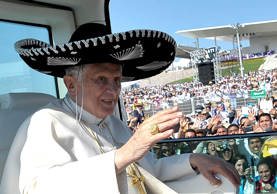Pope Benedict XVI waves from the popemobile wearing a Mexican sombrero as he arrives to give a Mass in Bicentennial Park near Silao, Mexico, Sunday, March 25, 2012. (AP / Osservatore Romano)