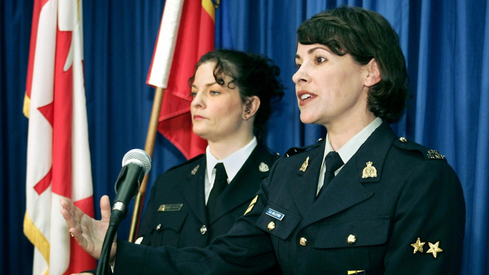 RCMP Cpl. Catherine Galliford (right) answers media questions as Vancouver Police Sgt. Sheila Sullivan looks on at left during a news conference in Vancouver Wednesday, Oct. 6, 2004. (Chuck Stoody / THE CANADIAN PRESS)