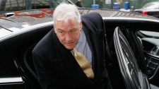 Former media mogul Conrad Black arrives at federal court in Chicago, Thursday, Jan. 13, 2011. (AP / Charles Rex Arobasgt)