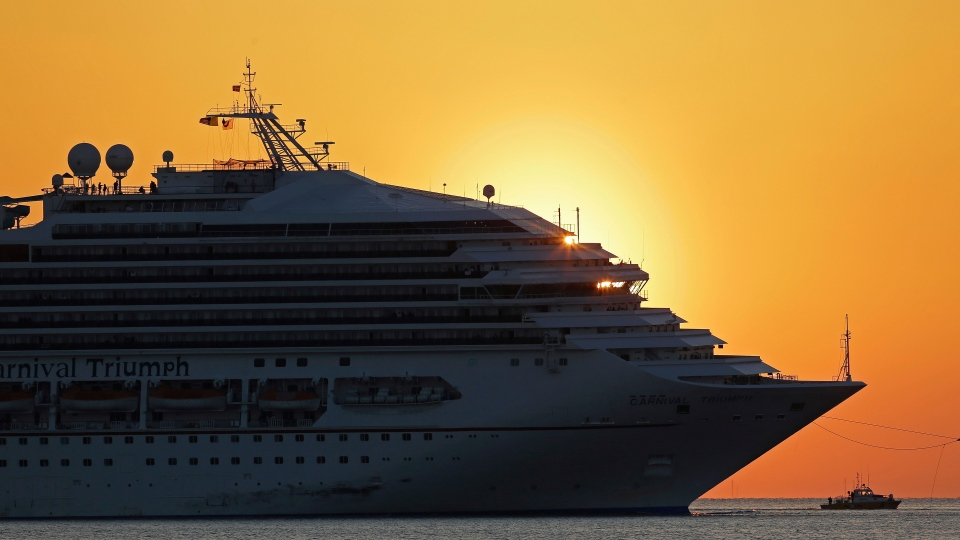 The cruise ship Carnival Triumph is towed into Mobile Bay near Dauphin Island, Ala., Thursday, Feb. 14, 2013. (AP / Dave Martin)