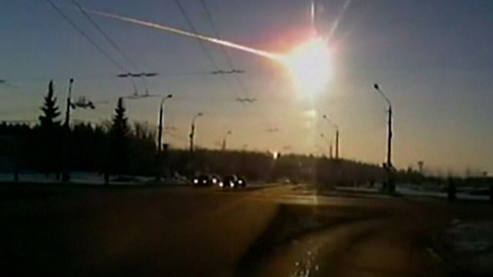 A meteor rockets across the sky in Russia's Ural Mountains, as seen in this image taken from amateur footage taken Friday, Feb. 15, 2013.