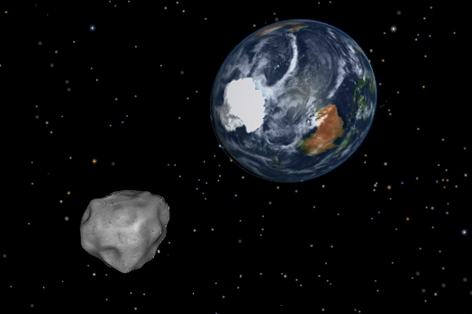A simulation of asteroid 2012 DA14 is seen approaching from the south as it passes through the Earth-moon system on Friday, Feb. 15, 2013. (NASA/JPL-Caltech)