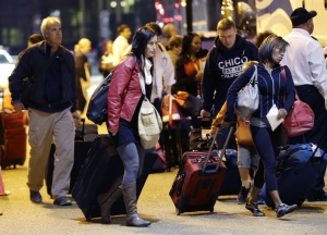 Passengers from the disabled Carnival Triumph cruise ship arrive by bus at the Hilton Riverside Hotel in New Orleans, Friday, Feb. 15, 2013. (AP / Gerald Herbert)