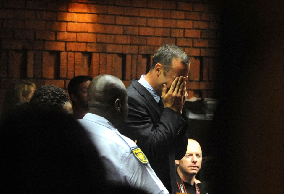 Oscar Pistorius weeps in court in Pretoria, South Africa at his bail hearing in the murder case of his girlfriend Reeva Steenkamp, Friday, Feb 15, 2013. (Antione de Ras / Independent Newspapers Ltd South Africa)