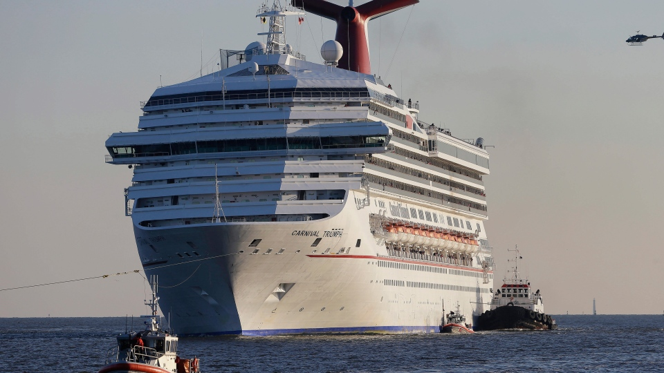 The cruise ship Carnival Triumph is towed into Mobile Bay near Dauphin Island, Alabama. (AP / Dave Martin)