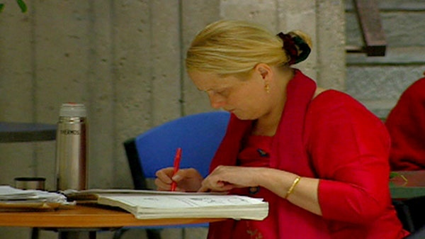 A woman is seen studying.