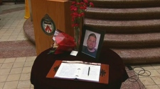 A book of condolences for the family of Sgt. Ryan Russell is seen at the Toronto Police Headquarters in Toronto, Thursday, Jan. 13, 2011.