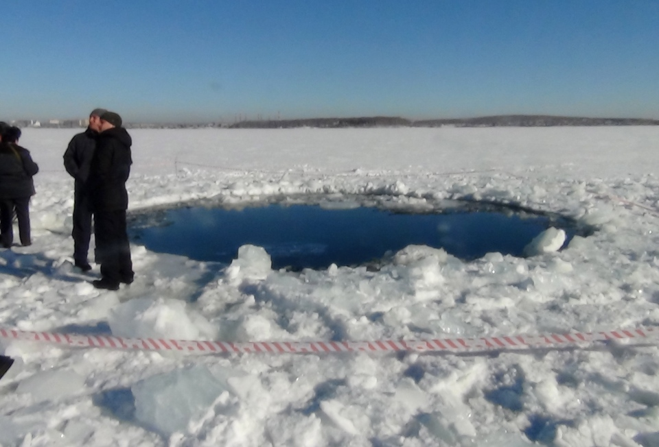 A circular hole is pictured in the ice of Chebarkul Lake, where a meteor struck, near Chelyabinsk, Russia on Friday, Feb. 15, 2013. (AP)