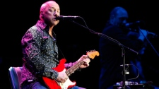 British musician Mark Knopfler , well known his time when he played with the band 'Dire Straits', performs on stage at the Festhalle in Frankfurt am Main, Germany, on Monday, June 7, 2010. (AP / dapdMario Vedder)