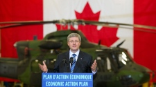 Prime Minister Stephen Harper speaks to employees during a visit to  the Bell Textron plant  Friday, January 14, 2011  in Mirabel, Quebec. (Ryan Remiorz / THE CANADIAN PRESS)