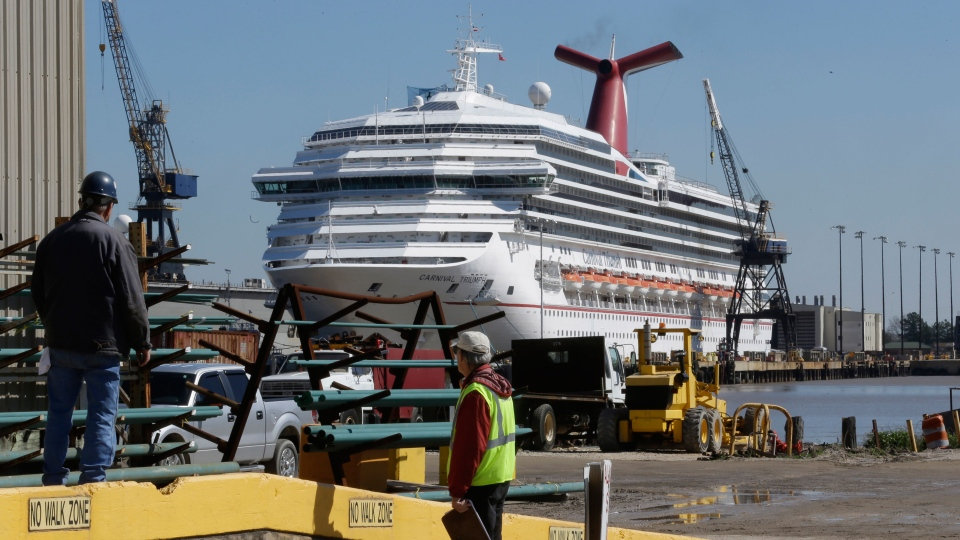 Workers look in the direction of the cruise ship Carnival Triumph in Mobile, Ala., Friday, Feb. 15, 2013. (AP / Dave Martin)