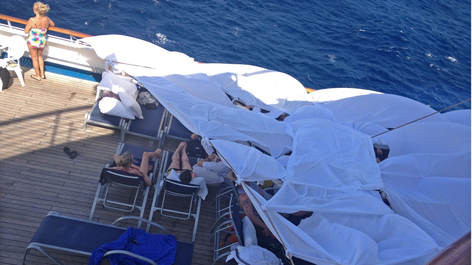 This undated photo provided by passenger Don Hoggatt, of Dallas, shows makeshift tents on the deck of the Carnival Triumph cruise ship for people to spend the day in and sleep in to escape the stench from the lower decks of the disabled ship. (AP / Don Hoggatt)