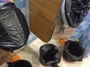 Covered urinals and bagged trash cans for passengers to use in one of the bathrooms aboard the Carnival Triumph cruise ship which became disabled after an engine-room fire left the ship powerless off Mexico last weekend. (AP / Don Hoggatt)