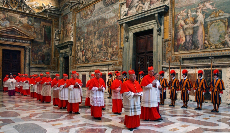 Cardinals walk in procession to the Sistine Chapel at the beginning of the conclave at the Vatican on April 18, 2005. (Osservatore Romano)