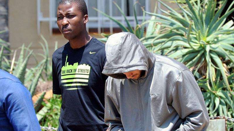 Olympic athlete Oscar Pistorius leaves the Boschkop police station, east of Pretoria, South Africa, Thursday, Feb. 14, 2013. (AP / Chris Collingridge)