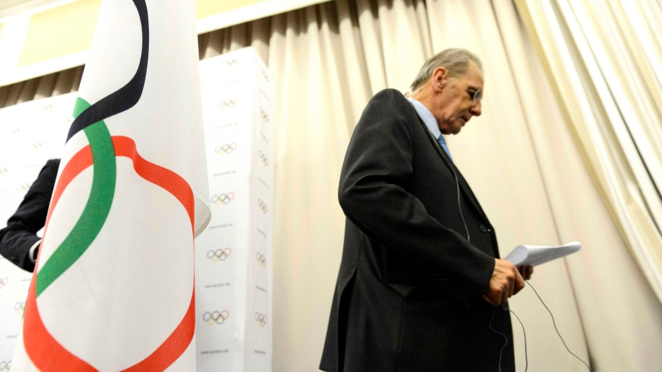 International Olympic Committee President Jacques Rogge leaves a press conference after the last day of the executive board's meeting, in Lausanne, Switzerland, Wednesday, Feb. 13, 2013. (Keystone, Laurent Gillieron)
