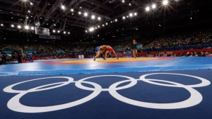Sayed Abdelmonem Hamed of Egypt competing against Zaur Kuramagomedov of Russia (in blue) during the 60-kg Greco-Roman wrestling competition at the 2012 Summer Olympics in London, Aug. 6, 2012. (AP / Paul Sancya)