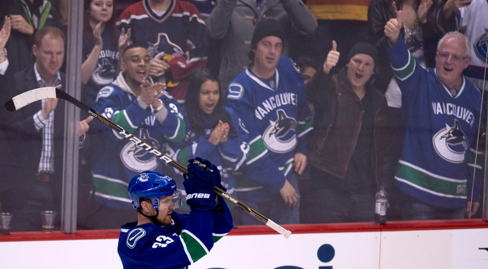 Vancouver Canucks center Henrik Sedin waves to the crowd following his assist during the second period of NHL hockey action against the Dallas Stars at Rogers Arena in Vancouver, B.C. Friday, Feb.15, 2013. Henrik Sedin now leads the franchise scoring record beating former Canuck Markus Naslund. THE CANADIAN PRESS/Jonathan Hayward