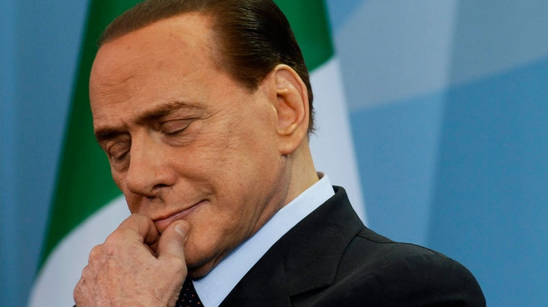 Italian Prime Minister Silvio Berlusconi listens during a joint news conference with German Chancellor Angela Merkel, not pictured, during the 28th government consultations of both nations at the chancellery in Berlin, Germany, Wednesday, Jan. 12, 2011. (AP / Shane McMillan)