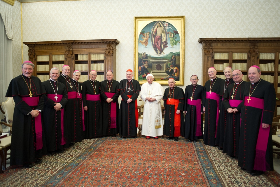 Pope Benedict XVI, centre, poses for a family picture with Bishops and Cardinals of the Italian Lombardy region during a private audience at the Vatican on Saturday, Feb. 16, 2013.  (AP / Osservatore Romano, ho)