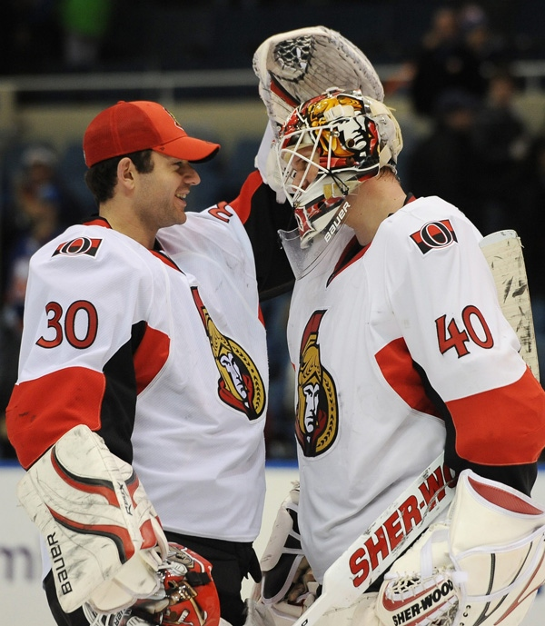 Ottawa Senators goalie Brian Elliott (30) congratulates goalie Robin Lehner (40) of Sweden at the end of the NHL hockey game after the Senators beat the New York Islanders 6-4 Thursday, Jan. 13, 2011, in Uniondale, N.Y. Lehner had his first win in his NHL debut. (AP Photo/Kathy Kmonicek)