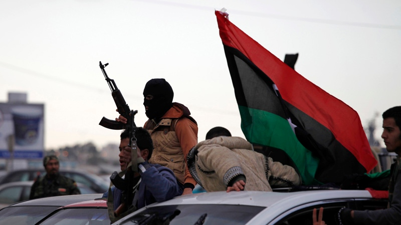 Libyan gunman celebrate on the early morning of the second anniversary of the revolution that ousted Moammar Gadhafi, in Benghazi, Libya, Sunday, Feb. 17, 2013. (AP / Mohammad Hannon)