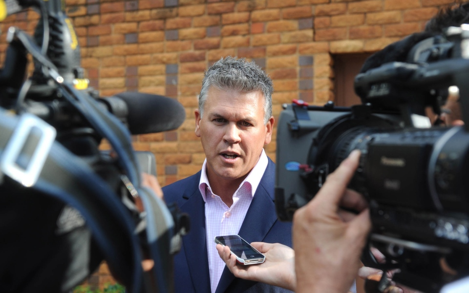 Peet van Zyl, managing agent for Olympian athlete Oscar Pistorius, talks to the press outside the Brooklyn police station after visiting Pistorius in Pretoria, South Africa on Sunday, Feb. 17, 2013. (AP)