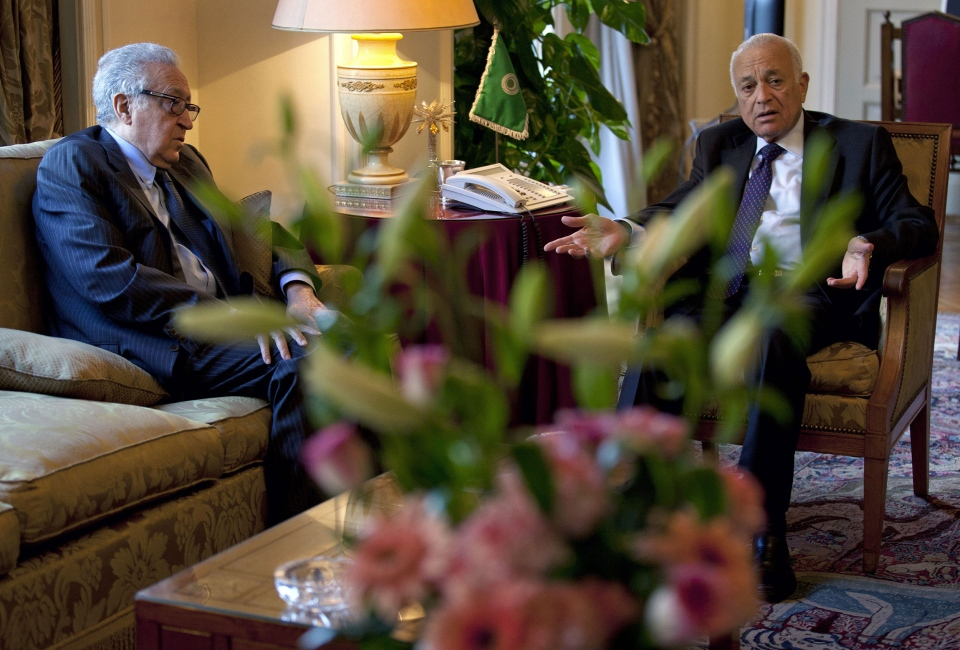 Arab League chief Nabil Elaraby, right, talks with U.N.-Arab League envoy to Syria Lakhdar Brahimi during their meeting at the Arab League headquarters, in Cairo, Egypt on Sunday, Feb. 17, 2013.  (AP / Nasser Nasser)