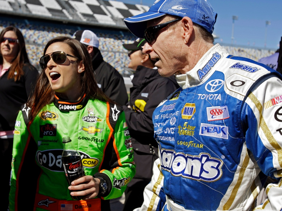 Mark Martin, right, and Danica Patrick laugh on pit road after their qualifying runs for the NASCAR Daytona 500 Sprint Cup Series auto race at Daytona International Speedway, Sunday, Feb. 17, 2013, in Daytona Beach, Fla. (AP / John Raoux)