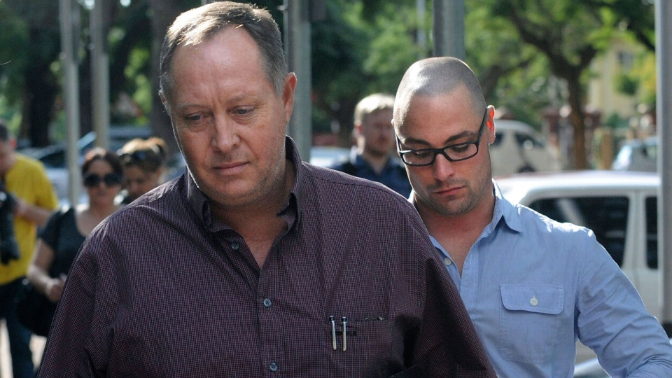 Kenny Oldwage, lawyer for Oscar Pistorius, foreground, and Carl Pistorius, brother of Oscar Pistorius, arrive at the Brooklyn police station in Pretoria, South Africa, Sunday, Feb. 17, 2013. (AP)