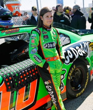 Danica Patrick stands by her car on pit road after qualifying for the NASCAR Daytona 500 Sprint Cup Series auto race at Daytona International Speedway in Daytona Beach, Fla. on Sunday, Feb. 17, 2013. (AP / Terry Renna)