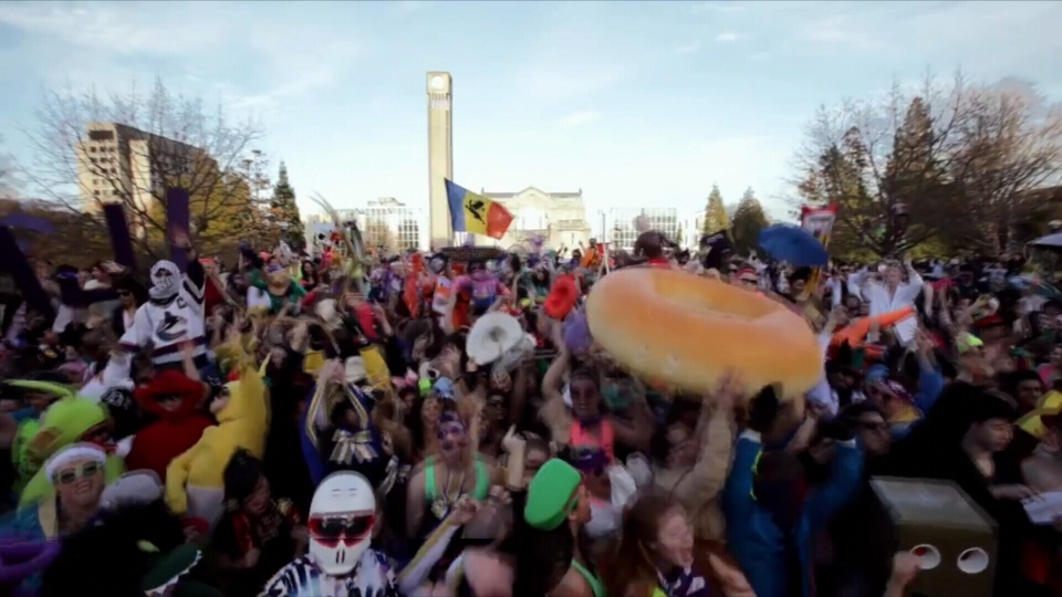 "1,400 pack the Koerner Library Plaza to show their version of the ""Harlem Shake."" (Hollis Mason)"