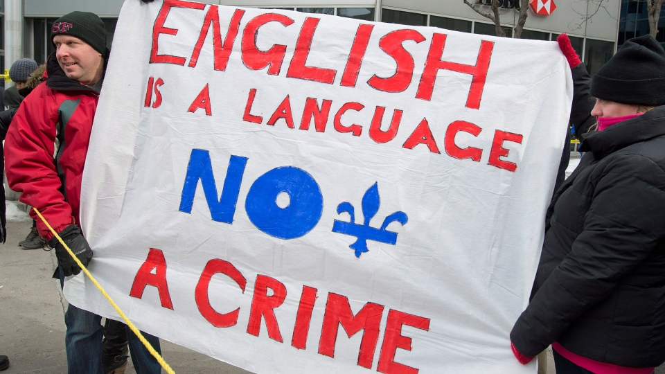 Protesters opposing language Bill 14 demonstrate outside the office of Quebec Premier Pauline Marois in Montreal on Sunday, Feb. 17, 2013. (Graham Hughes / THE CANADIAN PRESS)