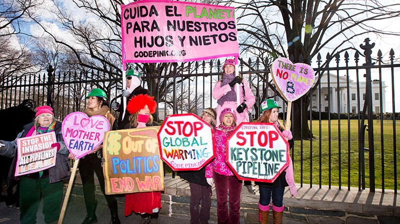 Elizabeth Barger, Noor Mir, Debra Van Poolen, Amanda Chartier, Mediya Benjamin and Alli McCracken stand with other protesters in front of the White House in Washington, Sunday, Feb. 17, 2013. (AP / Manuel Balce Ceneta)