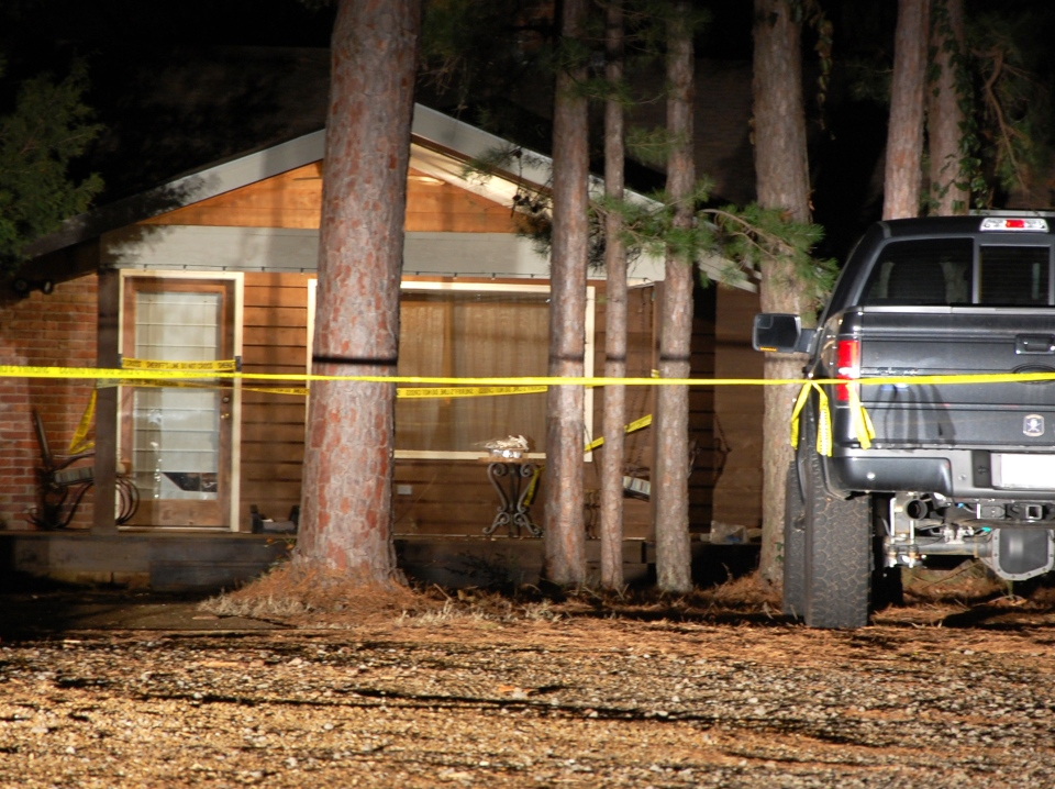 Yellow crime-scene tape blocks off the front of a home in Heber Springs, Ark., where country singer Mindy McCready was found dead in an apparent suicide on Sunday, Feb. 17, 2013. She was 37. (AP / Jeannie Nuss)