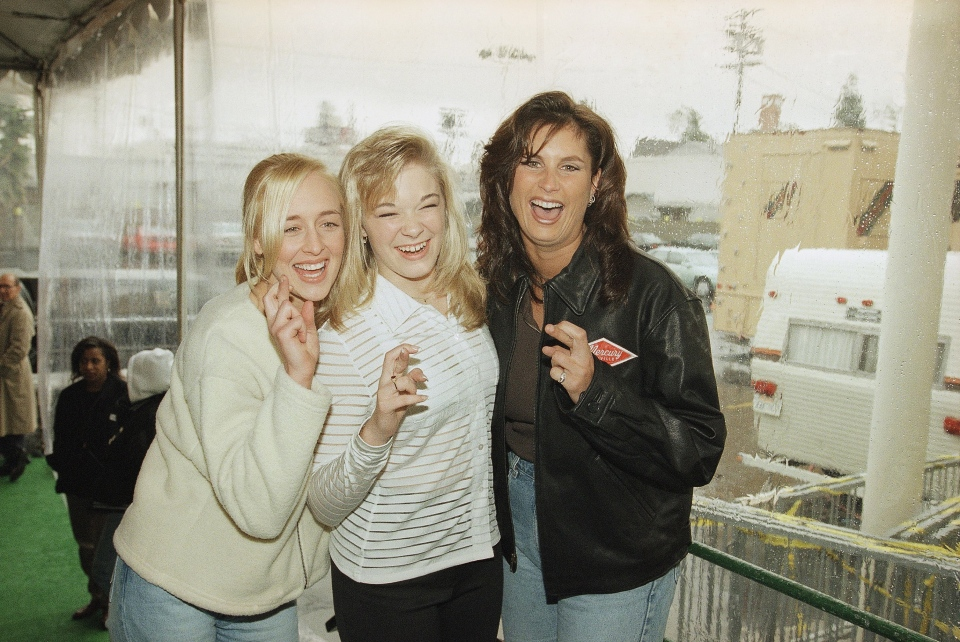 Country music singers Mindy McCready, left, LeAnn Rimes and Terri Clark joke around after a rehearsal for the American Music Awards at the Shrine Auditorium in Los Angeles, Jan. 26, 1997. (AP / Michael Caulfield)