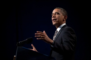 U.S. President Barack Obama gestures as he speaks at Hyde Park Academy in Chicago on Friday, Feb. 15, 2013. (AP / Evan Vucci)