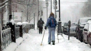 Residents use the snow to their advantage, making their way through town on skis in downtown Fredericton, N.B., in this Sunday, Feb. 17, 2013 file photo.