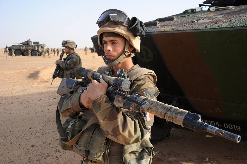 A French army sniper stands next to an armored vehicle outside Bourem, northern Mali, on Feb. 17, 2013. (AP / Pascal Guyot)