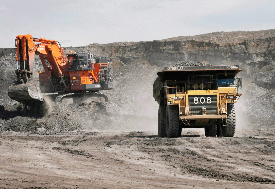 A haul truck carrying a full load drives at the Shell Albian Sands oilsands mine near Fort McMurray, Alta., in this 2008 file photo. (Jeff McIntosh / THE CANADIAN PRESS)