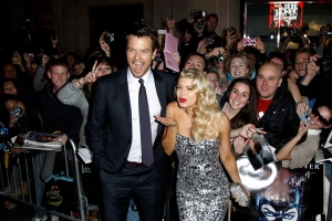 """Josh Duhamel, left, and Fergie arrive at the premiere of """"New Year's Eve"""" in Los Angeles in December 2011. (AP / Matt Sayles)"""