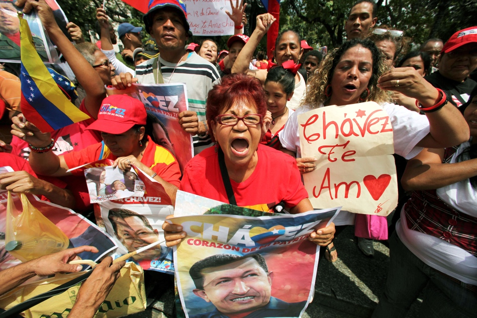 Supporters of Venezuela's President Hugo Chavez celebrate his return at Bolivar Square in Caracas, Venezuela, Monday, Feb. 18, 2013. (AP / Fernando Llano)