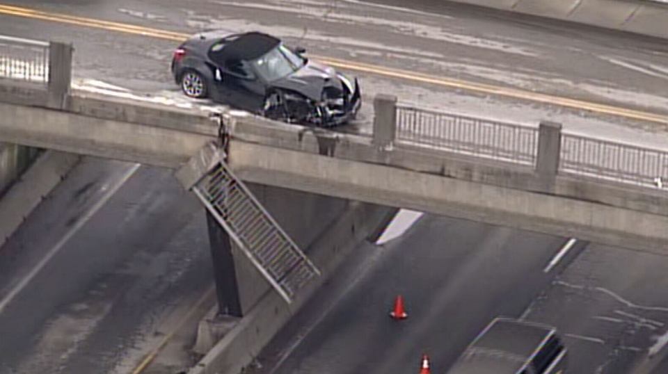 A car crashed into the railing on the Steveston Overpass Feb. 18, sending it tumbling onto the highway below. (CTV)